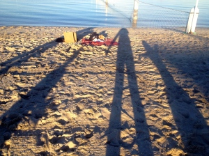 Creating long shadows of our bodies in the late afternoon sun