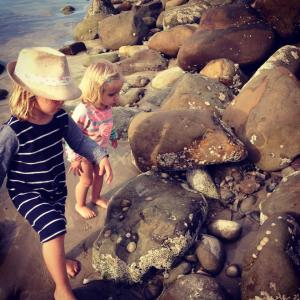 Exploring the rocks to find crabs